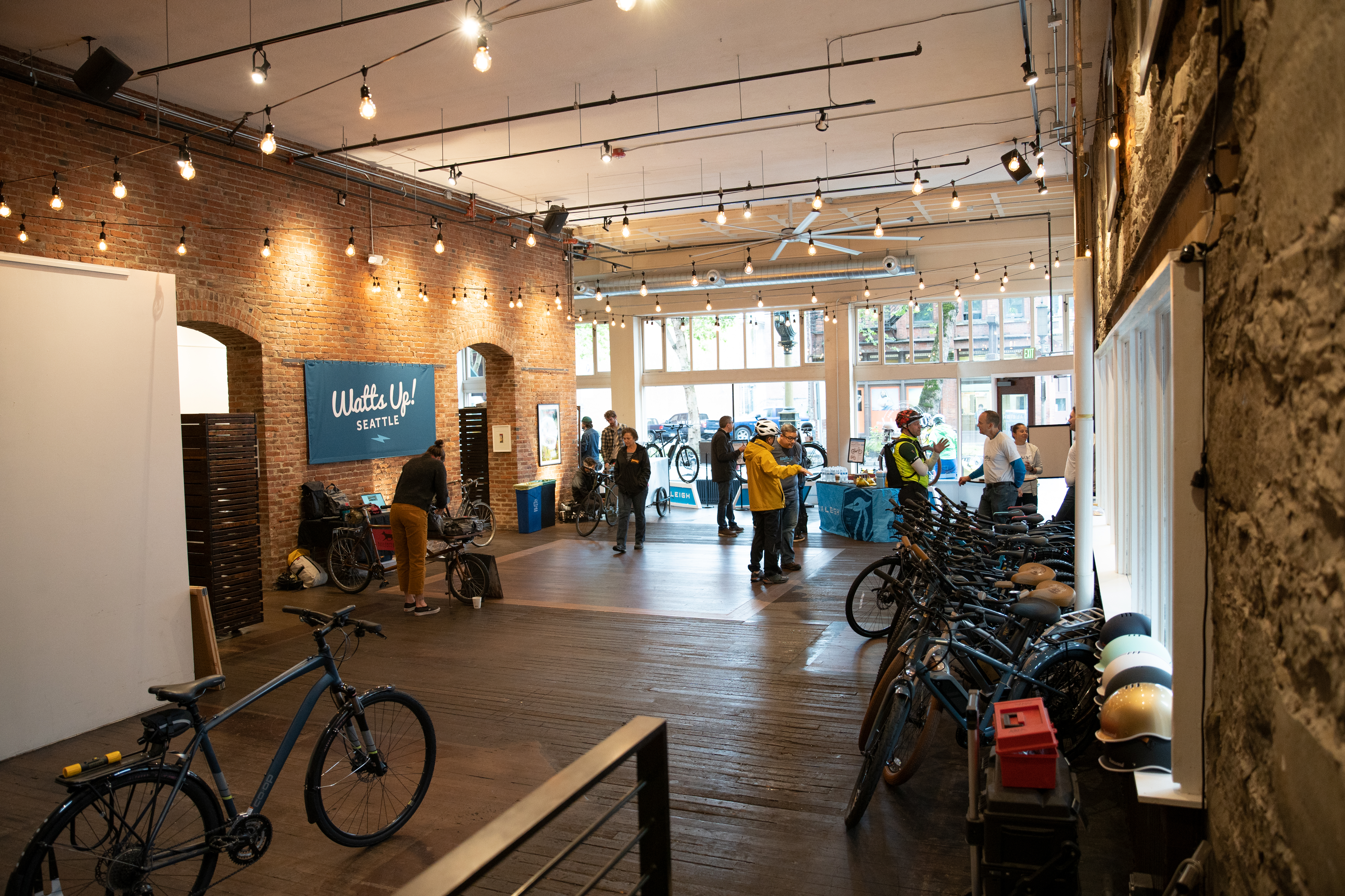 Interior of Watts Up Seattle pop-up shop showing a row of demo e-bikes