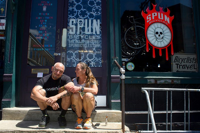 Dominic and Judi outside of their shop in Cincinnati. Image courtesy of Spun Bicycles.