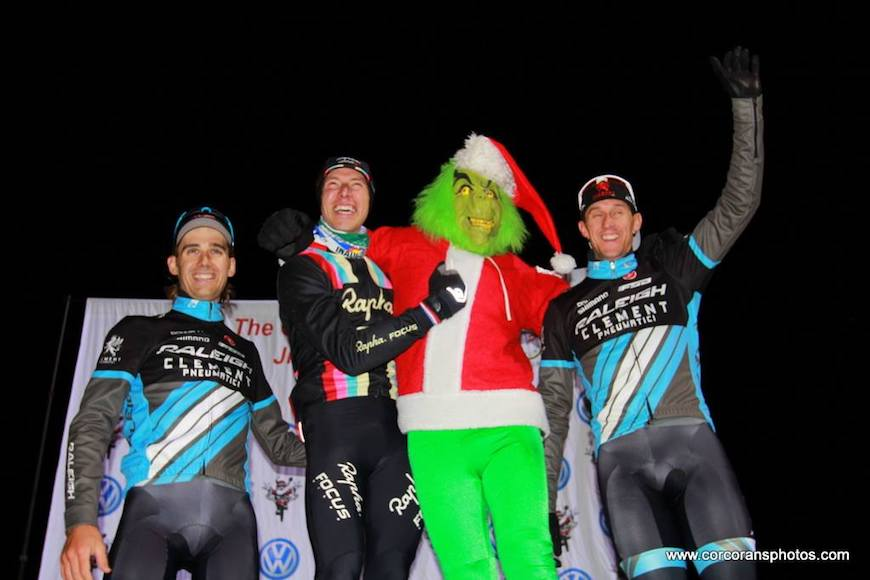 Ben Berden & Jamey Driscoll stand on the podium with the Grinch.