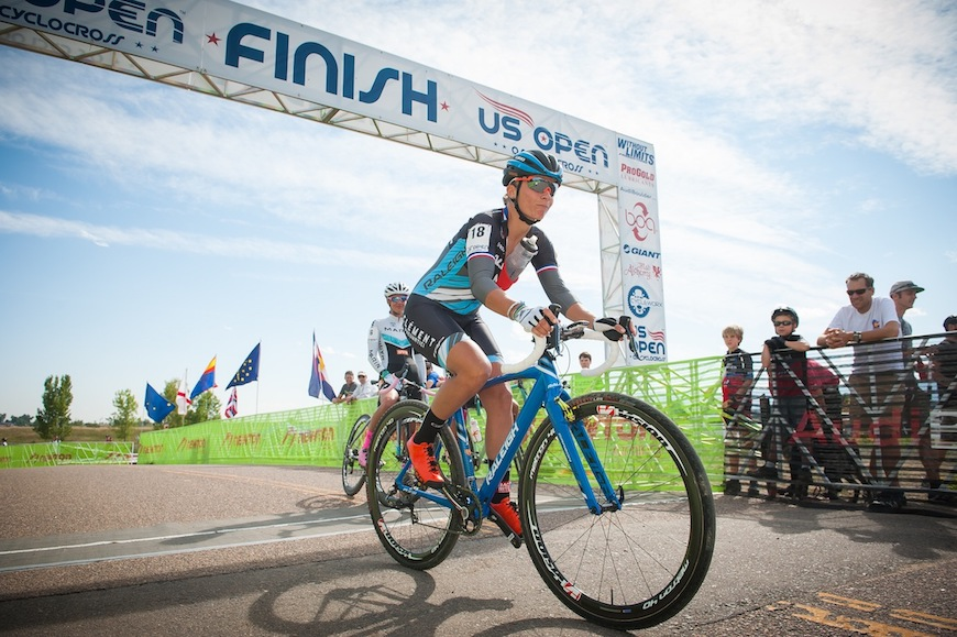 Caroline Mani crosses the finishline. Photo credit: Dejan Smaic